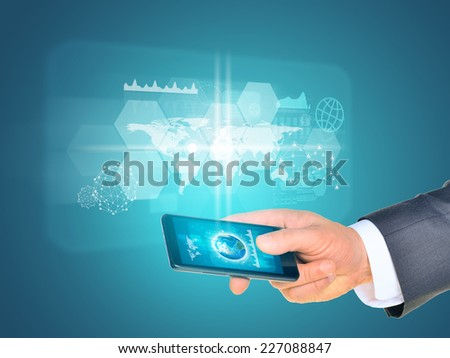 Man hand using smart phone. Earth on phone screen. World map near phone. Element of this image furnished by NASA