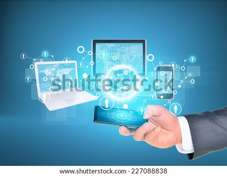 Man hand using smart phone. Electronics near Earth. Laptop, internet tablet and phone. Element of this image furnished by NASA - stock photo