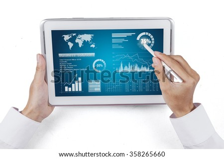 Man hand using stylus pen for touching the digital tablet with business chart on a screen - stock photo
