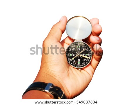 Man hand with a black and silver compass on white .close up view. - stock photo