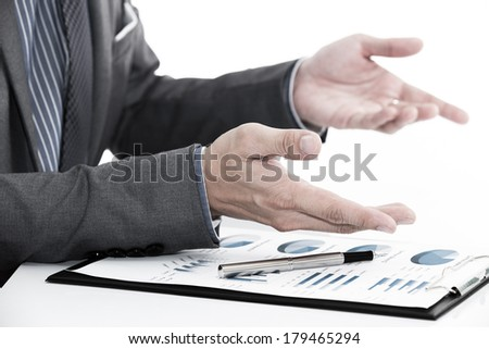 man hand with business report on table