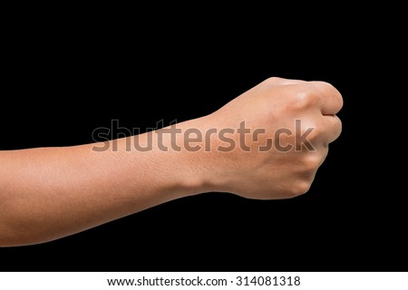 Man hand with clenched fist on black background - stock photo