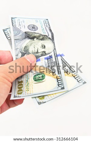Man hand with 100 dollar bills isolated on a white background