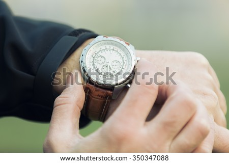 Man hand with elegant expensive watch with leather strap - stock photo