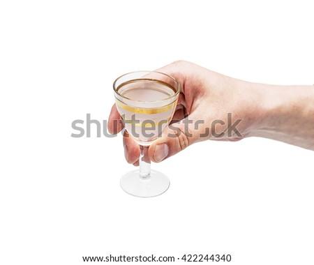 Man hand with glass of vodka , close up, Shot glasses of vodka on white background, addiction to alcohol.  studio shot - stock photo