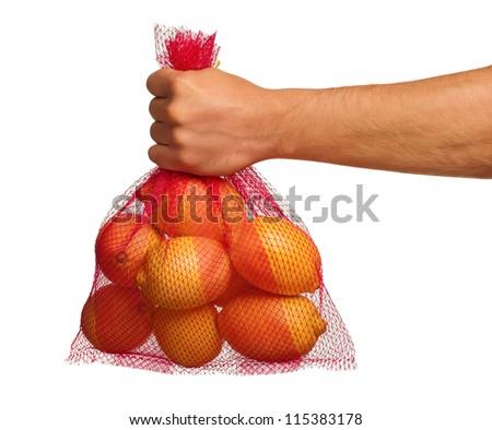 Man hand with net bag of fresh lemons isolated on white background - stock photo