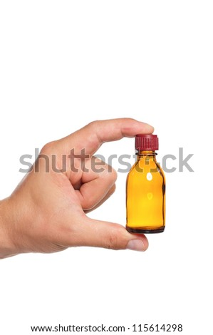 Man hand with small bottle isolated on white background - stock photo