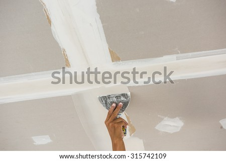 man hand trowel plastering ceiling skim stock photo edit. Black Bedroom Furniture Sets. Home Design Ideas