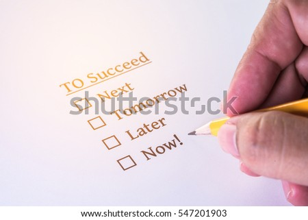 man hand with yellow pencil on survey form