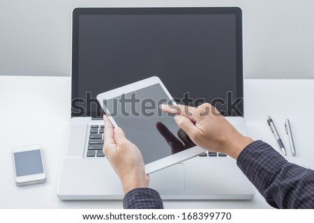 Man hand working with tablet with computer background. Technology.  - stock photo