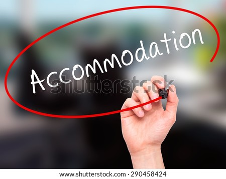 Man Hand writing Accommodation with black marker on visual screen. Isolated on office. Life, technology, internet concept. Stock Image - stock photo