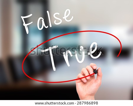 Man Hand writing an choosing True instead of False with black marker on visual screen. Isolated on office. Business, technology, internet concept. Stock Image - stock photo