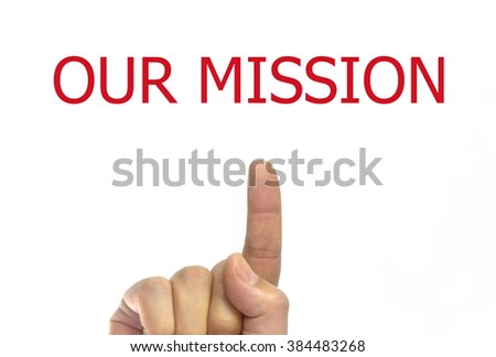man hand writing and to point the finger Our Mission on a transparent wipe board. Business Concept. Mission of a Company