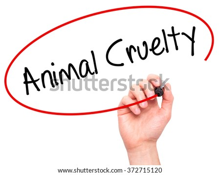 Man Hand writing Animal Cruelty with black marker on visual screen. Isolated on background. Business, technology, internet concept. Stock Photo - stock photo
