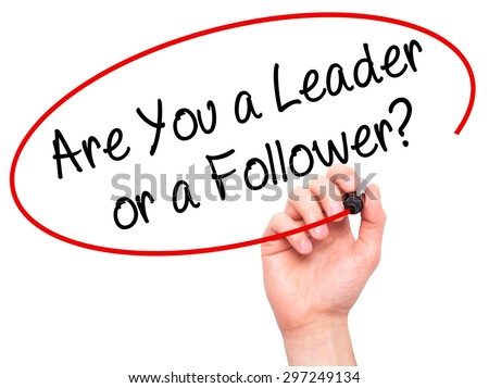 Man Hand writing Are You a Leader or a Follower? with black marker on visual screen. Isolated on white. Business, technology, internet concept. Stock Photo - stock photo