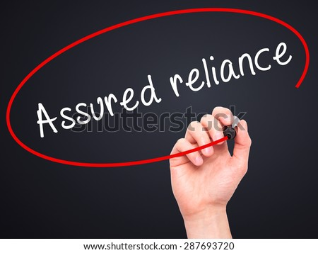 Man Hand writing Assured reliance with black marker on visual screen. Isolated on black. Business, technology, internet concept. Stock Image - stock photo