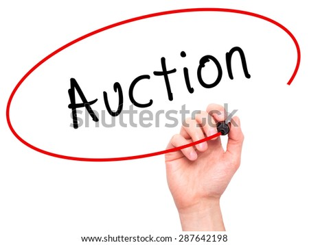 Man Hand writing Auction with black marker on visual screen. Isolated on white. Business, technology, internet concept. Stock Image - stock photo