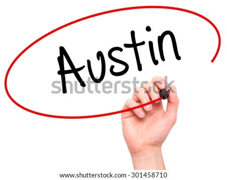 Man Hand writing Austin  with black marker on visual screen. Isolated on white. Business, technology, internet concept. Stock Photo - stock photo