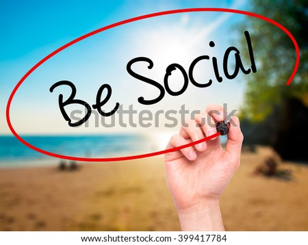 Man Hand writing Be Social with black marker on visual screen. Isolated on background. Business, technology, internet concept. Stock Photo - stock photo
