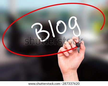 Man Hand writing Blog with marker on transparent wipe board. Isolated on office. Business, internet, technology concept. Stock Photo - stock photo