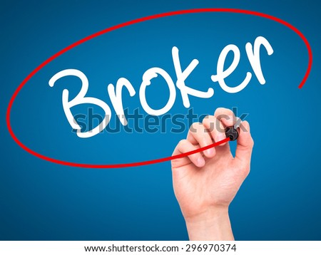 Man Hand writing Broker with black marker on visual screen. Isolated on blue. Business, technology, internet concept. Stock Photo - stock photo