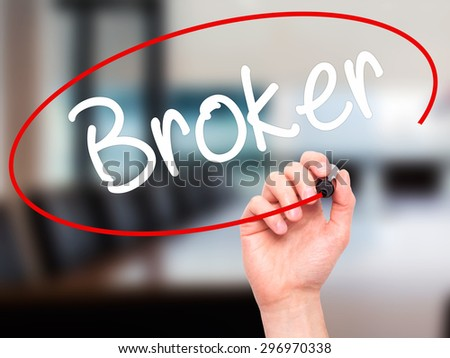 Man Hand writing Broker with black marker on visual screen. Isolated on office. Business, technology, internet concept. Stock Photo - stock photo