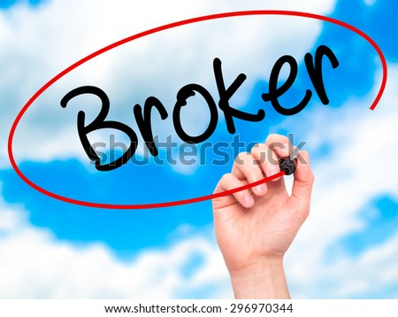 Man Hand writing Broker with black marker on visual screen. Isolated on sky. Business, technology, internet concept. Stock Photo - stock photo