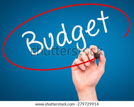 Man Hand writing Budget with marker on transparent wipe board. Isolated on blue. Business, internet, technology concept. Stock Photo  - stock photo
