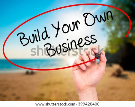 Man Hand writing Build Your Own Business with black marker on visual screen. Isolated on background. Business, technology, internet concept. Stock 