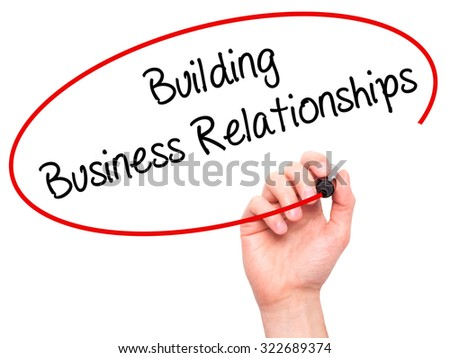 Man Hand writing  Building Business Relationships  with black marker on visual screen. Isolated on white. Business, technology, internet concept. Stock Photo - stock photo