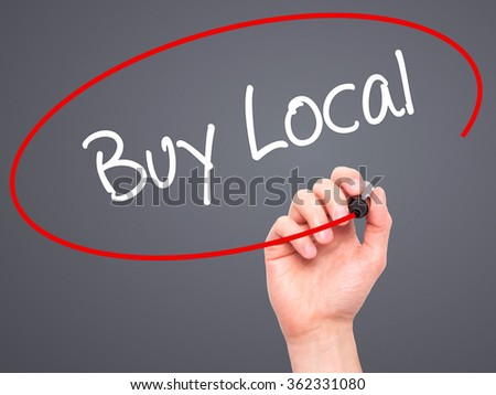 Man Hand writing Buy Local  with black marker on visual screen. Isolated on background. Business, technology, internet concept. Stock Photo - stock photo
