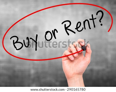 Man Hand writing Buy or Rent? with black marker on visual screen. Isolated on grey. Business, technology, internet concept. Stock Image - stock photo