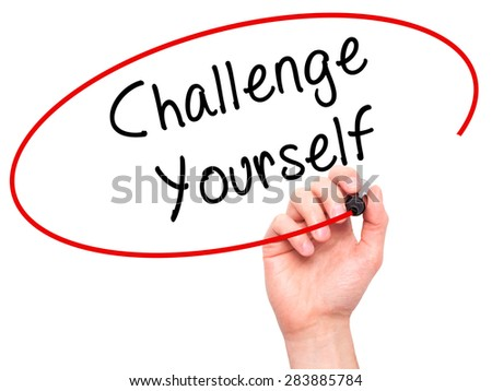 Man Hand writing Challenge Yourself with marker on transparent wipe board. Isolated on white. Business, internet, technology concept. Stock Photo - stock photo