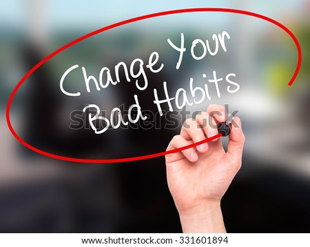 Man Hand writing Change Your Bad Habits  with black marker on visual screen. Isolated on office. Business, technology, internet concept. Stock Photo - stock photo
