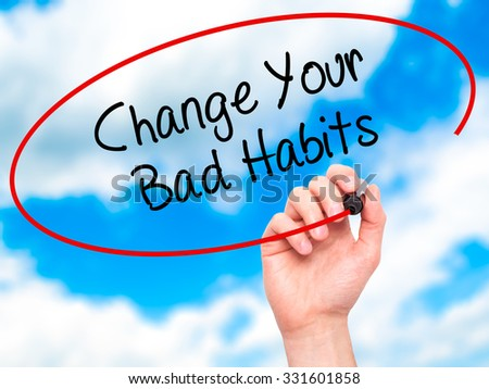 Man Hand writing Change Your Bad Habits  with black marker on visual screen. Isolated on sky. Business, technology, internet concept. Stock Photo - stock photo