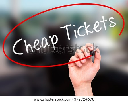 Man Hand writing Cheap Tickets with black marker on visual screen. Isolated on background. Business, technology, internet concept. Stock Photo - stock photo