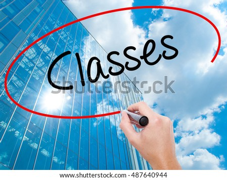 Man Hand writing Classes   with black marker on visual screen. Business, technology, internet concept.