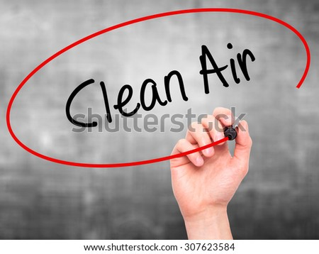 Man Hand writing Clean Air with black marker on visual screen. Isolated on grey. Business, technology, internet concept. Stock Photo - stock photo