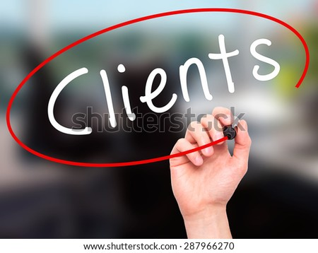 Man Hand writing Clients with black marker on visual screen. Isolated on office. Business, technology, internet concept. Stock Image - stock photo