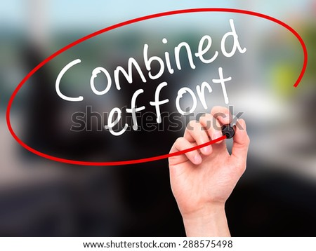 Man Hand writing Combined effort with black marker on visual screen. Isolated on office. Business, technology, internet concept. Stock Image - stock photo