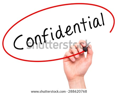 Man Hand writing Confidential with black marker on visual screen. Isolated on white. Business, technology, internet concept. Stock Image - stock photo
