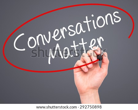 Man Hand writing Conversations Matter with black marker on visual screen. Isolated on grey. Business, technology, internet concept. Stock Image - stock photo