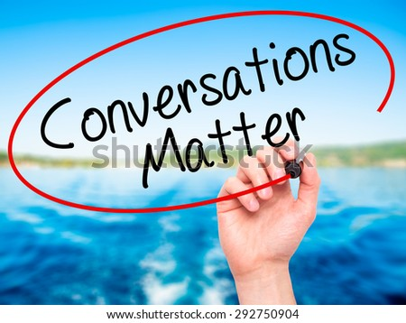 Man Hand writing Conversations Matter with black marker on visual screen. Isolated on nature. Business, technology, internet concept. Stock Image - stock photo
