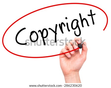 Man hand writing Copyright on visual screen. Business,help, internet, technology concept. Isolated on white. Stock Photo - stock photo