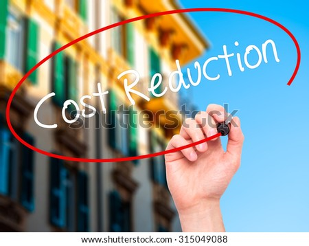 Man Hand writing Cost Reduction with black marker on visual screen. Isolated on city. Business, technology, internet concept. Stock Photo - stock photo