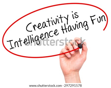 Man Hand writing Creativity is Intelligence Having Fun with black marker on visual screen. Isolated on white. Business, technology, internet concept. Stock Photo - stock photo
