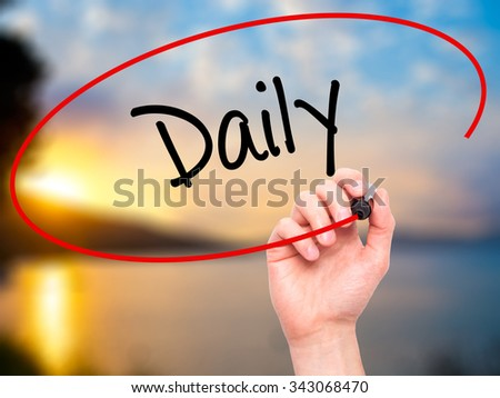 Man Hand writing Daily with black marker on visual screen. Isolated on nature. Business, technology, internet concept. Stock Photo - stock photo