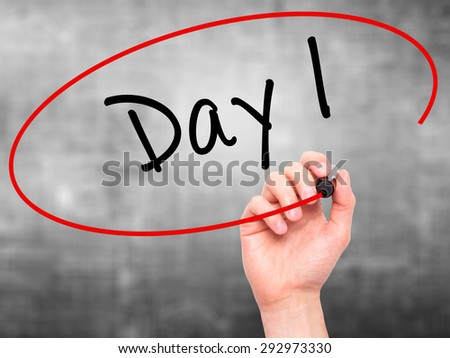Man Hand writing Day 1 with black marker on visual screen. Isolated on grey. Business, technology, internet concept. Stock Image