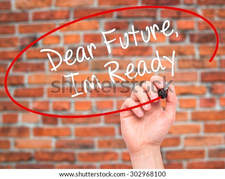 Man Hand writing Dear Future, Im Ready with black marker on visual screen. Isolated on bricks. Business, technology, internet concept. Stock Photo - stock photo