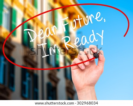 Man Hand writing Dear Future, Im Ready with black marker on visual screen. Isolated on city. Business, technology, internet concept. Stock Photo - stock photo